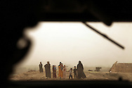 Marshland Arab family in Maysan Province seen out of the window of an MRAP driven by members of the 1st Cavalry Division atbased  at Hunter  forward operating base