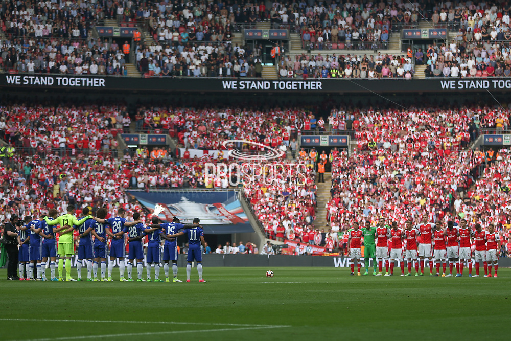 The teams observe a minutes silence for true victims of the Manhester bombing during the The FA Cup final match between Arsenal and Chelsea at Wembley Stadium, London, England on 27 May 2017. Photo by Shane Healey.
