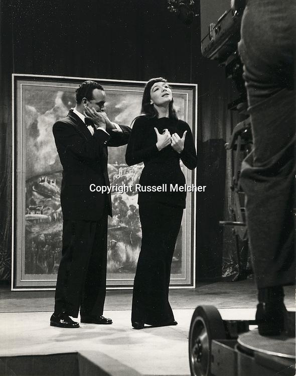 Juliette Greco singing on the TV Show with Larry Adler playing the harmonica.<br /> <br /> <br /> Juliette Greco chantant, accompagnee par Larry Adler sur l'harmonica, pendant le tournage de l'emission &quot;That's your Life&quot;