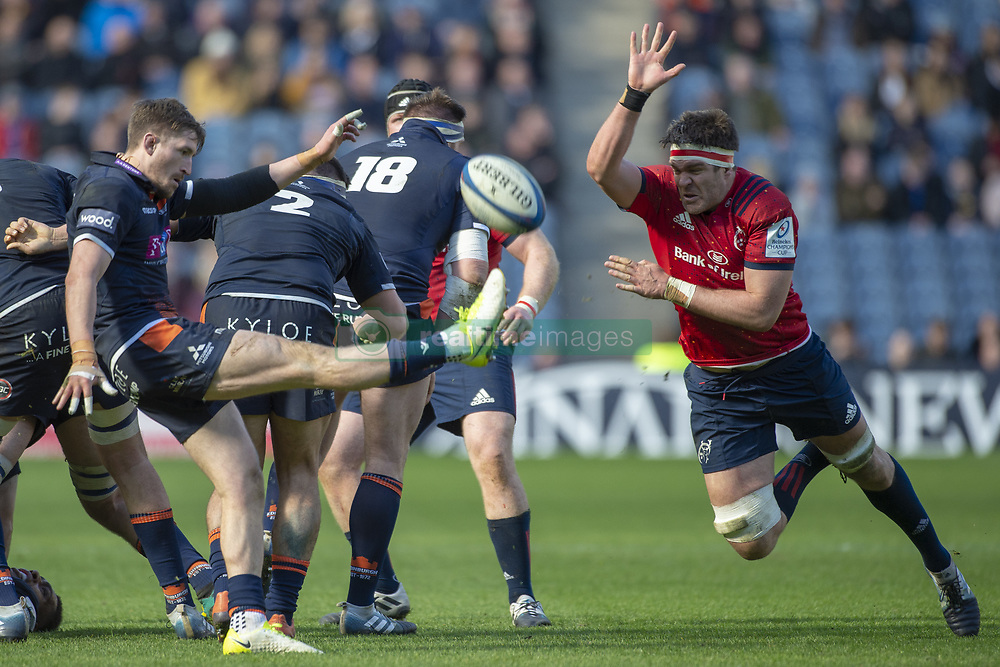 March 30, 2019 - Edinburgh, Scotland, United Kingdom - Henry Pyrgos of Edinburgh kicks the ball and Billy Holland of Munster during the Heineken Champions Cup Quarter Final match between Edinburgh Rugby and Munster Rugby at Murrayfield Stadium in Edinburgh, Scotland, United Kingdom on March 30, 2019  (Credit Image: © Andrew Surma/NurPhoto via ZUMA Press)