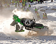NEWS&amp;GUIDE PHOTO / PRICE CHAMBERS<br /> Todd Tupper's snowmobile sheds parts on impact as it tumbles down Snow King mountain on Saturday. The Hailey, Idaho rider was thrown from the sled as he neared the top of the 4,000 foot course that claimed many costly machines over the weekend.