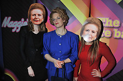 Guests wearing Lady Thatcher masks and Lady Thatcher lookalike at a private screening of the film The Iron Lady hosted by nightclub Maggie's held at Cineworld, King's Road, London on 19th January 2012.