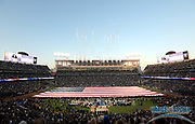 Sep 10, 2018; Oakland, CA, USA; General overall view of the Oakland-Alameda County Coliseum during the playing of the national anthem with a United States flag on the field before the NFL game between the Los Angeles Rams and the Oakland Raiders.