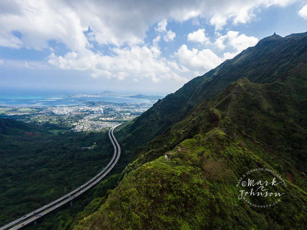 Aerial photograph of 2 male hikers looking at Haiku Valley from the Moanalua Saddle, Koolau Mountains, Oahu, Hawaii