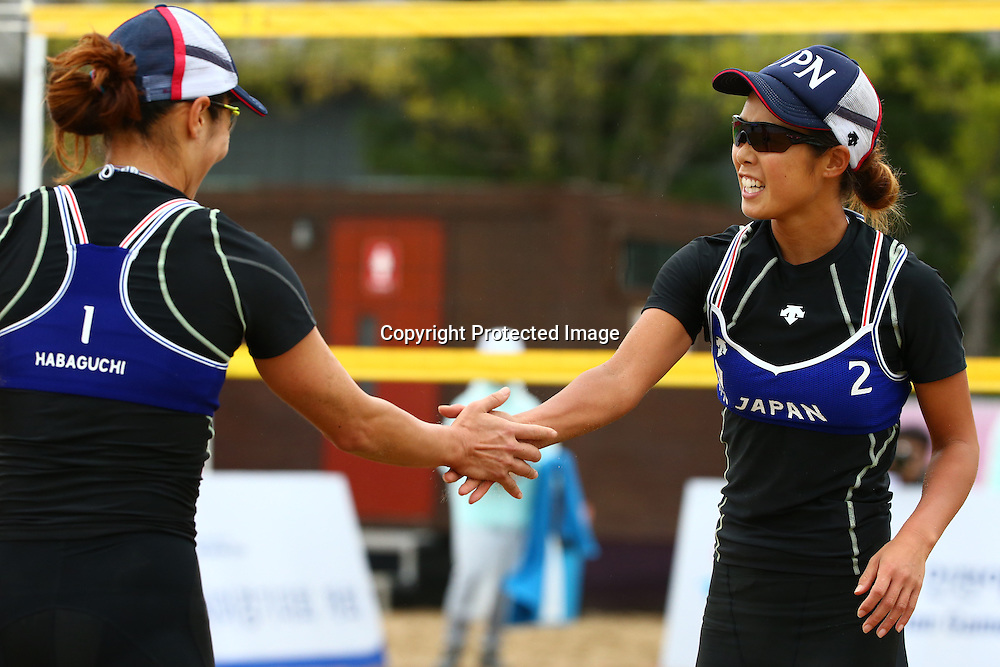 Erika Habaguchi &amp; Megumi Murakami (JPN), <br /> SEPTEMBER 24, 2014 - Beach Volleyball : <br /> Women's Preliminary Round <br /> at Munhak Beach Volleyball Venue <br /> during the 2014 Incheon Asian Games in Incheon, South Korea. <br /> (Photo by Shingo Ito/AFLO SPORT)