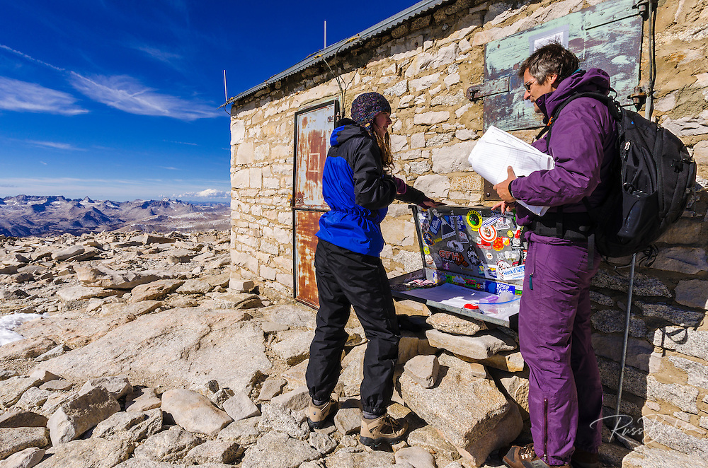 Hikers at the summit hut and register on Mount Whitney, Sequoia National Park, Sierra Nevada Mountains, California USA