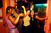 Four drunk women get rowdy and dance, U.K, 1990s.