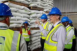August 10, 2017 - Dar es Salaam, Tanzania - Philanthropist Bill Gates toured a new fertilizer terminal in the port of Dar es Salaam, run by Yara International, an agriculture products company. Gates was accompanied by managing director Alexandre Macedo. ''If you care about the poorest, you care about agriculture,'' Gates said. According to the World Bank, agriculture is the primary economic activity for 80 percent of Tanzania's population. Gates visited the country's largest private fertilizer manufacturer to learn how small-holder farmers can get access to better inputs to improve their productivity. (Credit Image: © Ric Francis via ZUMA Wire)