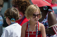 BAR HARBOR, MAINE, July 4, 2014. A young marcher has dressed in red, white and blue for the Independence Day Parade
