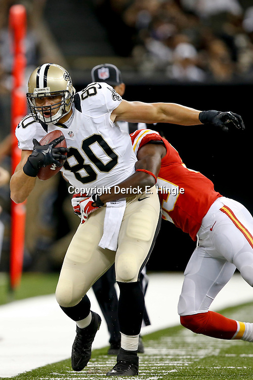 Aug 9, 2013; New Orleans, LA, USA; New Orleans Saints tight end Jimmy Graham (80) against the Kansas City Chiefs during a preseason game at the Mercedes-Benz Superdome. The Saints defeated the Chiefs 17-13. Mandatory Credit: Derick E. Hingle-USA TODAY Sports