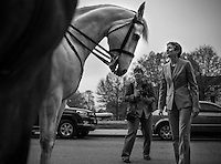 WASHINGTON, DC - APRIL 15:  On the way to being welcomed by staff on her first official day as Secretary of the Interior, Sally Jewel speaks to Park Service mounted police in front of the Department of Interior Monday morning April 15, 2013. Tami Heilemann, photographer to the Secretary, center. (Photo by Melina Mara/The Washington Post)