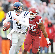 Ole Miss Rebels quarterback Ryan Buchanan (9) is chased by Arkansas Razorbacks defensive end Trey Flowers (86) at Donald W. Reynolds Razorback Stadium in Fayetteville, Ark. on Saturday, November 22, 2014.