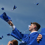 "BATH, Maine --  Austin Lewis throws his hat in the air at conclusion of the Morse High School graduation June 8. he gave the commencement speech.  Besides quoting three U.S. presidents, he said,""High School wasn't my thing."" He credited his late grandmother with giving him motivation to finish.  Photo © Roger S. Duncan 2014."