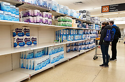 © Licensed to London News Pictures. 30/03/2020. London, UK. Shoppers looking at toilet rolls in Sainsbury's supermarket in north London, as stock begins to be available during coronavirus lockdown. Photo credit: Dinendra Haria/LNP