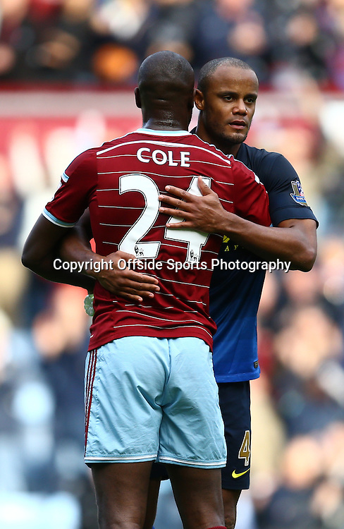 25 October 2014 - Barclays Premier League - West Ham v Manchester City - A dejected Vincent Kompany of Manchester City embraces Carlton Cole of West Ham - Photo: Marc Atkins / Offside.
