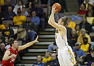 January 04 2010: Iowa Hawkeyes guard Matt Gatens (5) puts up a shot over Ohio State Buckeyes guard Jon Diebler (33) during the second half of an NCAA college basketball game at Carver-Hawkeye Arena in Iowa City, Iowa on January 04, 2010. Ohio State defeated Iowa 73-68.