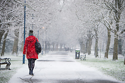 © Licensed to London News Pictures. 06/02/2018. Aberystwyth, UK.  Heavy flurries of snow fall in Aberystwyth, west Wales,  as people make their way to work and to school on a cold February morning in West Wales. Photo credit: Keith Morris/LNP