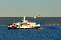 BC Ferries MV Quinsam car ferry with float plane taking off between Gabriola Island and Nanimo British Columbia Canada