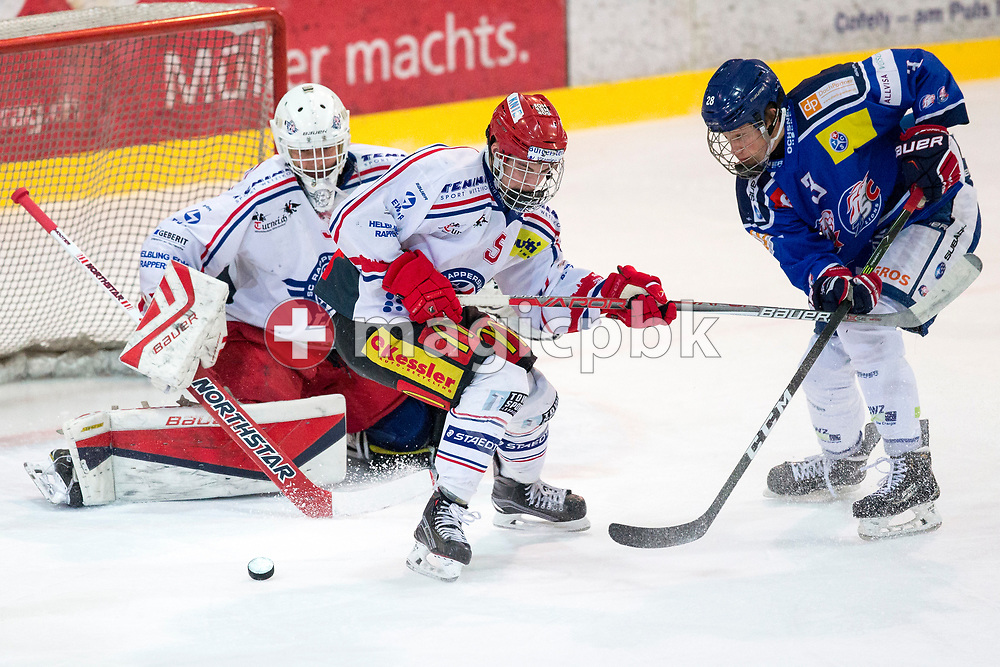 ZSC Lions forward Nils Pfister (R), Rapperswil-Jona Lakers goaltender Beat Trudel (L) and defenseman Janis Manser (C) battle for possession during the fourth Elite B Playoff Final ice hockey game between ZSC Lions and Rapperswil-Jona Lakers in Duebendorf, Switzerland, Friday, Mar. 17, 2017. (Photo by Patrick B. Kraemer / MAGICPBK)