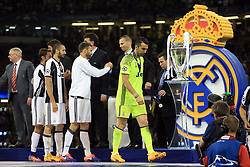 3 June 2017 - UEFA Champions League Final - Juventus v Real Madrid - A dejected Juventus goalkeeper Gianluigi Buffon walks past the trophy after collecting his losers medal - Photo: Marc Atkins / Offside.