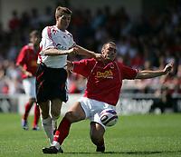 Photo: Paul Thomas.<br />Crewe Alexandra v Liverpool. Pre Season Friendly. 14/07/2007.<br /><br />Steven Gerrard (L) of Liverpool gets past Danny O'Donnell.