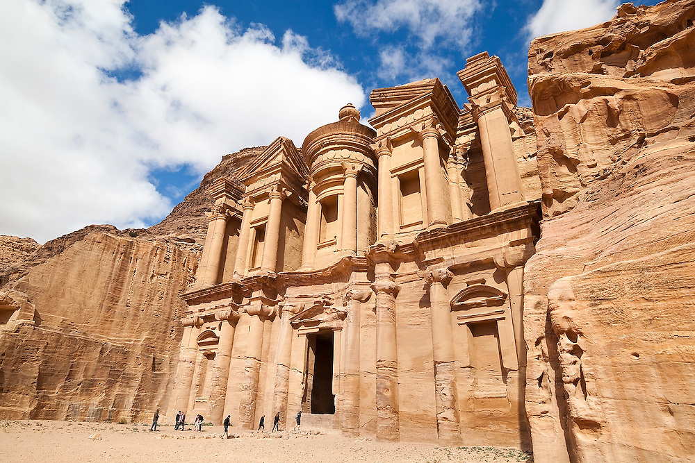 Tourists approach The Monastery (Al Deir) in Petra, Jordan.