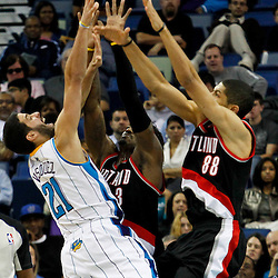 January 16, 2012; New Orleans, LA, USA; New Orleans Hornets point guard Greivis Vasquez (21) is defended by Portland Trail Blazers small forward Gerald Wallace (3) and Portland Trail Blazers small forward Nicolas Batum (88) during the third quarter of a game at the New Orleans Arena. The Trail Blazers defeated the Hornets 84-77.  Mandatory Credit: Derick E. Hingle-US PRESSWIRE