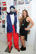 Maddie Bowman, U.S. Freeskiing hopeful, shows off the women's official halfpipe U.S. Freeskiing Competition Uniform designed and manufactured by The North Face, Monday, October 28, 2013, in New York. (Photo by Diane Bondareff/Invision for The North Face/AP)