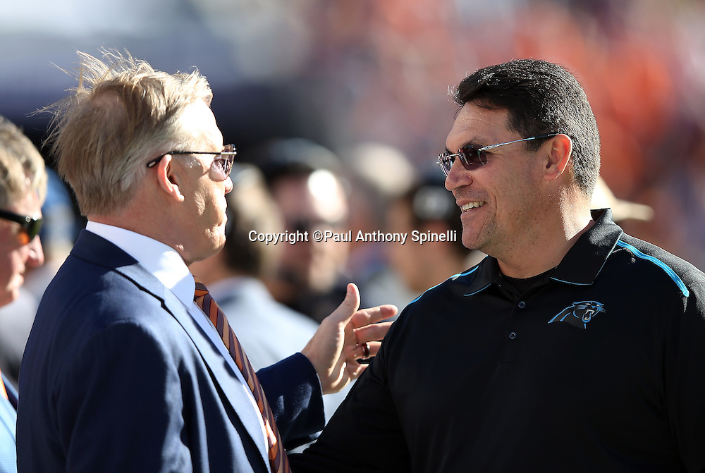 (R-L) Denver Broncos general manager John Elway talks to Carolina Panthers head coach Ron Rivera before the NFL Super Bowl 50 football game against the Denver Broncos on Sunday, Feb. 7, 2016 in Santa Clara, Calif. The Broncos won the game 24-10. (©Paul Anthony Spinelli)