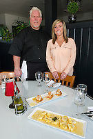 Managers Bob Wilson and Brianna Farley of Faro Italian Grille at Weirs Beach will be preparing Lemoncello Shrimp and Grand Tortellini dishes for the Taste of the Lakes Region event this weekend.  (Karen Bobotas/for the Laconia Daily Sun)