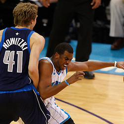 Mar 22, 2010; New Orleans, LA, USA; New Orleans Hornets guard Chris Paul (3) collides with Dallas Mavericks forward Dirk Nowitzki (41) during the first half at the New Orleans Arena. Mandatory Credit: Derick E. Hingle-US PRESSWIRE