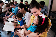 Jamielynn Tinkey, LCMS missionary to the Dominican Republic, cares for a young girl during worship at the LCMS Latin America regional office in Santiago, Dominican Republic, on Tuesday, Oct. 17, 2017. LCMS Communications/Erik M. Lunsford