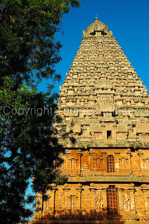 """The Brihadishwara Temple  also known as Rajarajeswaram, at Thanjavur, is the world's first complete granite temple and a brilliant example of the major heights achieved by Cholas in temple architecture. It is a tribute and a reflection of the power of its patron RajaRaja Chola I. It remains as one of the greatest glories of Indian architecture. The temple is part of the UNESCO World Heritage Site """"Great Living Chola Temples"""" and this temple is an ultimate testimonial for the vishwakarmas architectural cognizence in planning and sculpting this temple..This temple is one of India's most prized architectural sites. The temple stands amidst fortified walls that were probably added in the 16th century. The 'Vimana' - or the temple tower - is 216ft (66m) high [4] (about 70 meters) and is among the tallest of its kind in the world. The Kalash or 'Shikhara' (apex or the bulbous structure on the top) of the temple is of monolithic granite weighing 81.25 tons. There is a big statue of Nandi (sacred bull), carved out of a single rock, at the entrance measuring about 16 feet long and 13 feet high. The entire temple structure is made out of hard granite stones, a material sparsely available currently in Thanjavur area where the temple is located."""