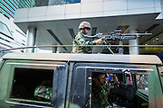 "01 JUNE 2014 - BANGKOK, THAILAND: A Thai soldier in an armed humvee arrives at Terminal 21, a Bangkok shopping mall, to put down a protest in the mall. The Thai army seized power in a coup that unseated a democratically elected government on May 22. Since then there have been sporadic protests against the coup. The protests Sunday were the largest in several days and seemed to be spontaneous ""flash mobs"" that appeared at shopping centers in Bangkok and then broke up when soldiers arrived. Protest against the coup is illegal and the junta has threatened to arrest anyone who protests the coup. There was a massive security operation in Bangkok Sunday that shut down several shopping areas to prevent the protests but protestors went to malls that had no military presence.    PHOTO BY JACK KURTZ"