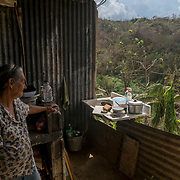 OCTOBER 13 - ADJUNTAS, PUERTO RICO - <br /> Liz Marin Sierra, 72, by the makeshift kitchen under her hurricane destroyed house in the Barrio Juan Gonzalez after the wind took off part of the room and water damaged the brand new wood panel walls in her house during  the path of  Hurricane Maria. <br /> (Photo by Angel Valentin/Freelance)