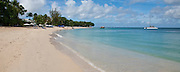 There are many beautiful spots to visit in Barbados along the coast.  From the rugged North Point to calm idealic West Coast and freshness of the South. All have their own natural beauty and must be seen.<br /> PAYNES BAY BEACH &amp; SAILING BOAT, BARBADOS