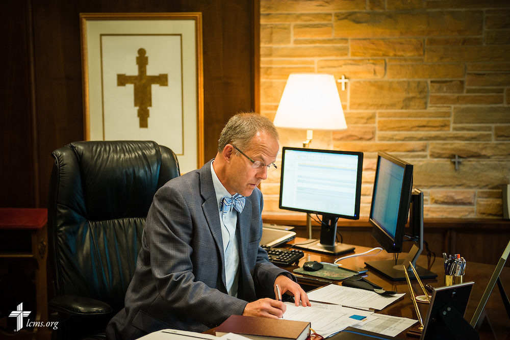 The Rev. Dr. Patrick T. Ferry, president of Concordia University Wisconsin in Mequon, Wis., works in his office on Tuesday, May 27, 2014. LCMS Communications/Erik M. Lunsford
