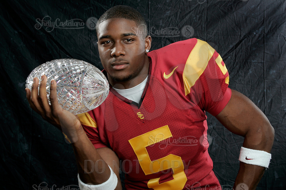 7 April 2005: USC Trojan Reggie Bush with the National Championship Crystal Football Trophy  For Editorial Use ONLY Credit must be given -  Photo by:  Shelly Castellano.com