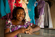 Ojiugi Ogbuji started her business in 2000, beginning with door to door sales of baby items. <br /> <br /> She later expanded into the unit next door and started selling soft drinks and water too. <br /> <br /> She attended the Youth for Technology business training first and then heard about the business advice SMS service. <br /> <br /> The main thing she learnt from the training was about the importance of eye-catching displays to attract people into the shop and also the value of loans.