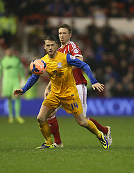 Preston North End's Joe Garner shields the ball from Nottingham Forest's Danny Collins - Photo mandatory by-line: Matt Bunn/JMP - Tel: Mobile: 07966 386802 24/01/2014 - SPORT - FOOTBALL - City Ground - Nottingham - Nottingham Forest v Preston North End - FA Cup - Fourth Round