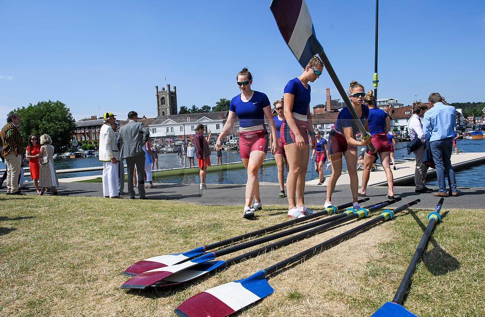 © Licensed to London News Pictures. 04/07/2018. Henley-on-Thames, UK. Rowers form Oxford Brookes Rowing Club carrying their oars at day one of the Henley Royal Regatta, set on the River Thames by the town of Henley-on-Thames in England. Established in 1839, the five day international rowing event, raced over a course of 2,112 meters (1 mile 550 yards), is considered an important part of the English social season. Photo credit: Ben Cawthra/LNP