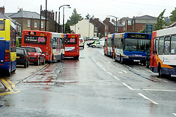 Torrential rain causes flooding and traffic chaos as buses are parked up between Minster Road and The Common, unable to make it back to the depot in Ecclesfield Sheffield South Yorkshire after bus services are cancelled due to adverse weather conditions.25 June 2007.Image COPYRIGHT Paul David Drabble.