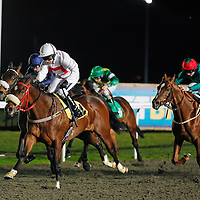 Basil Berry and Hayley Turner winning the 7.55 race