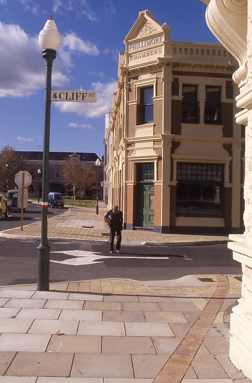 Old man crosses Cliff Street, Fremantle, Western Australia.