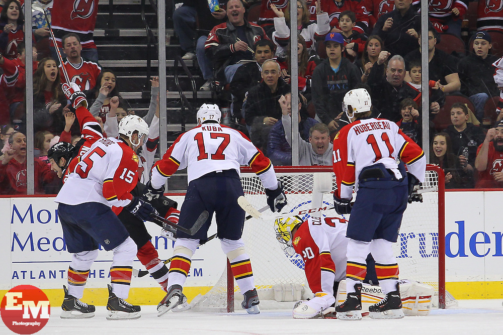 Mar 23, 2013; Newark, NJ, USA; New Jersey Devils center David Clarkson (23) celebrates his goal on Florida Panthers goalie Scott Clemmensen (30) during the second period at the Prudential Center.