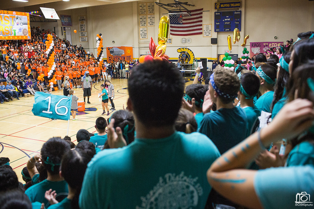 Milpitas High School juniors watch as their teammate competes in the Frozen T-shirt Contest during the annual Trojan Olympics, where students compete in various unorthodox events for class bragging rights, at Milpitas High School in Milpitas, California, on March 27, 2015. (Stan Olszewski/SOSKIphoto)