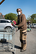 man with mask outdoors at a garden shop Limoux France April 2020