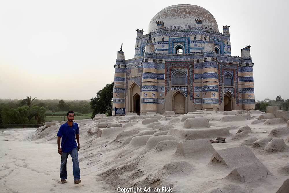 Celebrated young pakistani artist Asim Butt on a journey of political graffiti through Pakistan during the summer of 2009..In Uch Sharif Asim passes an ancient islamic tomb. He went to Uch Sharif to work on a piece title 'Original Sin' that refers to Mohammad Bin Qasim who came to this spot in 710 AD, the first muslim invader into south Asia bringing islam with him. Uch Sharif later became a centre for mystical Islam.