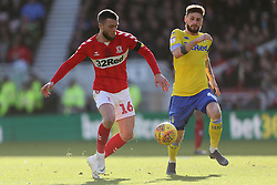 Middlesbrough's Jonathan Howson (left) and Leeds United's Mateusz Klich during the Sky Bet Championship match at The Riverside Stadium, Middlesbrough.