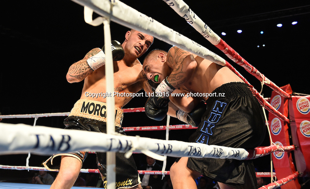Bowyn Morgan knocks down Nuka Gemmell at The Burger King Road to the Title by Duco Boxing at ILT Stadium Southland in Invercargill, New Zealand. Saturday 1 August 2015. Copyright photo: Andrew Cornaga / www.photosport.nz